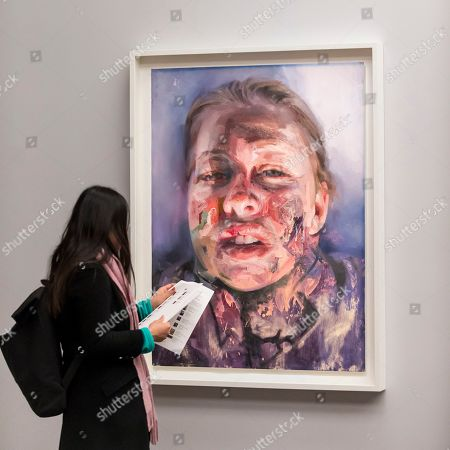 "A visitor viewing ""Untitled"", 2019, by Jenny Saville, a new work, seen for the first time, created in response to Rembrandt's self-portrait, ""Self-Portrait with Two Circles"" which is the highlight of the exhibition."