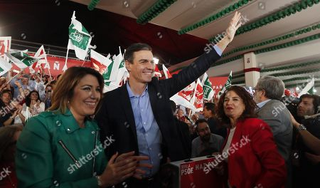 Stock Image of Spanish Prime Minister and Socialist Party (PSOE)'s Secretary General, Pedro Sanchez (C), Spanish Ministers of Treasury, Maria Jesus Montero (R) and PSOE's leader in Andalusia, Susana Diaz (L), greet people during an event held in Sevilla, Andalusia, Spain, 11 April 2019, prior the election campaign opening event of the Socialist Party (PSOE)'s. Spain will hold general elections on 28 April.