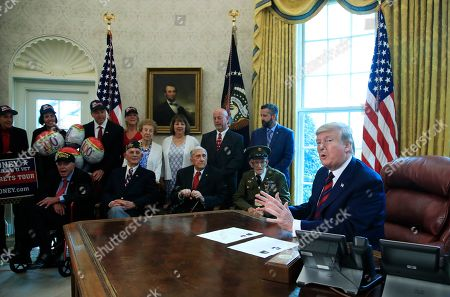 Donald Trump, Allen Jones, Paul Kriner, Sidney Walton, Floyd Wigfield. President Donald Trump is joined by World War II veterans in the Oval Office of the White House in Washington