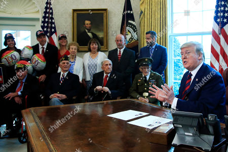 Donald Trump, Sidney Walton, Allen Jones, Paul Kriner, Floyd Wigfield. President Donald Trump is joined by World War II veterans, seated from left, Sidney Walton, Allen Jones, Paul Kriner and Floyd Wigfield, in the Oval Office of the White House in Washington