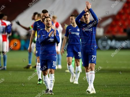 Stock Image of Chelsea's Eden Hazard, left, and Chelsea's Andreas Christensen applaud the fans after the UEFA Europa League quarterfinal soccer match between Slavia Prague and Chelsea at the Sinobo stadium in Prague, Czech Republic, . Chelsea won the match 0-1