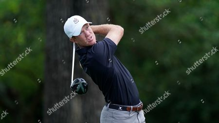 Kevin O'Connell hits a drive on the second hole during the first round for the Masters golf tournament, in Augusta, Ga