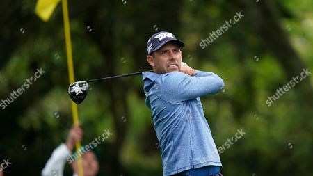 Stock Image of Charl Schwartzel, of South Africa, hits on the second hole during the first round for the Masters golf tournament, in Augusta, Ga