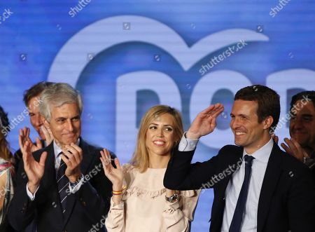 President of People's Party (PP) Pablo Casado (R), his wife Isabel Torres (C), and party's member Adolfo Suarez Illana (L) react during an election campaign opening event of the People's Party (PP) in Madrid, Spain, 11 April 2019. Spain will hold general elections on 28 April.