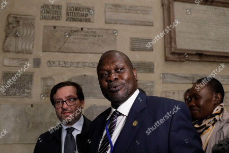 South Sudan Deputy-President Riek Machar arrives to attend a prayer for peace event at the Basilica of Santa Maria in Trastevere, in Rome, . A retreat at the Vatican for the leaders of South Sudan enters its second day, a month before the end of the pre-transitional period of a shaky peace deal. South Sudan President Salva Kiir is meeting with opposition leader Riek Machar