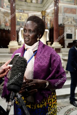 Rebecca Garang arrives to attend a prayer for peace event at the Basilica of Santa Maria in Trastevere, in Rome, . A retreat at the Vatican for the leaders of South Sudan enters its second day, a month before the end of the pre-transitional period of a shaky peace deal. South Sudan President Salva Kiir is meeting with opposition leader Riek Machar