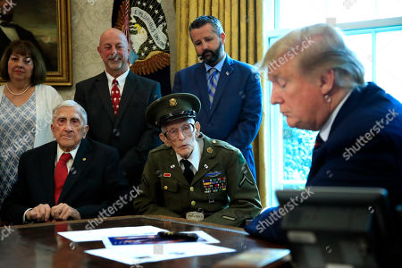 Donald Trump, Paul Kriner, Floyd Wigfield, Allen Jones, Sidney Walton. President Donald Trump listens to World War II veterans, seated from left, Paul Kriner and Floyd Wigfield, in the Oval Office of the White House in Washington