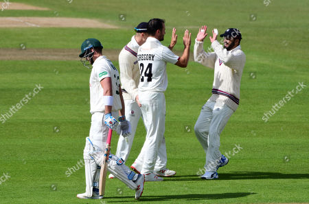 Lewis Gregory of Somerset celebrates taking the wicket of Joe Clarke of Nottinghamshire