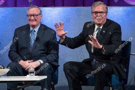 Philadelphia Mayor Jim Kenney, left, and former Florida Gov. Jeb Bush take part in a forum on the opioid epidemic, at the University of Pennsylvania in Philadelphia