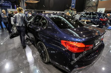 Stock Image of Visitors look at the new e-hybrid MBW 530e car, display at the e-Motor show, in Beirut, Lebanon, 11 April 2019. The e-Motor Show is the First car show in the Middle East for electric and hybrid cars which opened its doors in Beirut for five days from 11 to 15 April 2019, displaying the latest models of hybrid and electric cars that came to Lebanon.