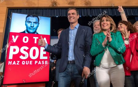 Spanish Prime Minister and Socialist Party (PSOE)'s Secretary General, Pedro Sanchez (L), and PSOE's leader in Andalusia, Susana Diaz (2-R), pose for the photographers next to a poster of Pedro Sanchez during the election campaign opening event of the Socialist Party (PSOE)'s held in Sevilla, Andalusia, Spain, 11 April 2019. Spain will hold general elections on 28 April.
