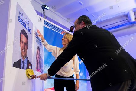 President of Catalonian People's Party (PPC), Alejandro Fernandez (R), and PP's head of list for Barcelona, Cayetana Alvarez de Toledo (L), install a poster of the President of People's Party (PP), Pablo Casado, during the election campaign opening event of the People's Party held in Barcelona, Catalonia, Spain, 12 April 2019.