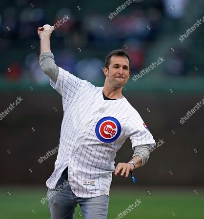 Actor Noah Wyle throws out a ceremonial first pitch before the Chicago Cubs' baseball game against the Pittsburgh Pirates in Chicago
