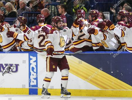 Stock Picture of Minnesota-Duluth Bulldogs forward Justin Richards (19) celebrates after scoring a goal to give the Bulldogs a 1-0 lead during the second period of play in the NCAA Frozen Four Men's Hockey Semi-Final game between the Providence Friars and Minnesota-Duluth Bulldogs at the KeyBank Center in Buffalo , N.Y. (Nicholas T. LoVerde/Cal S\pfport Media)