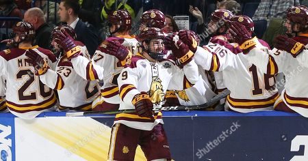 Stock Photo of Minnesota-Duluth Bulldogs forward Justin Richards (19) celebrates with teammates after scoring a goal to give the Bulldogs a 1-0 lead during the second period of play in the NCAA Frozen Four Men's Hockey Semi-Final game between the Providence Friars and Minnesota-Duluth Bulldogs at the KeyBank Center in Buffalo , N.Y. (Nicholas T. LoVerde/Cal S\pfport Media)