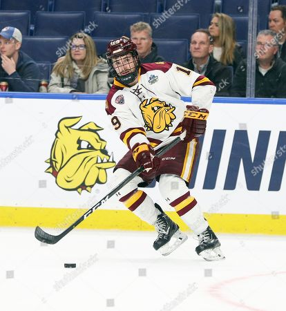 Minnesota-Duluth Bulldogs forward Justin Richards (19) scored 2 goals for the Bullsdogs in the NCAA Frozen Four Men's Hockey Semi-Final game between the Providence Friars and Minnesota-Duluth Bulldogs at the KeyBank Center in Buffalo , N.Y. Minnesota-Duluth defeated Providence 4-1 to advance to the National Final game on Saturday, th, 2019. (Nicholas T. LoVerde/Cal S\pfport Media)