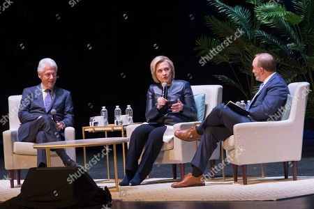 "Bill Clinton, Hillary Rodham Clinton, Paul Begala. Former President Bill Clinton, left, and Paul Begala, right, listen and former Secretary of State Hillary Rodham Clinton speaks during ""An Evening with the Clintons"", at the Beacon Theatre in New York"