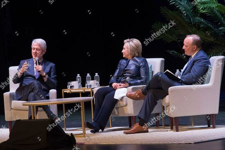 "Bill Clinton, Hillary Rodham Clinton, Paul Begala. Paul Begala, right, and former Secretary of State Hillary Rodham Clinton, center, listen as former President Bill Clinton speaks during ""An Evening with the Clintons"", at the Beacon Theatre in New York"