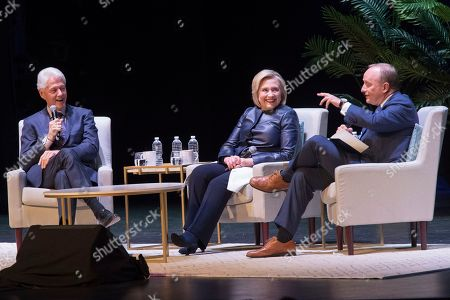 "Bill Clinton, Hillary Rodham Clinton, Paul Begala. Former President Bill Clinton, left, and former Secretary of State Hillary Rodham Clinton, center, smile as Paul Begala speaks during ""An Evening with the Clintons"", at the Beacon Theatre in New York"
