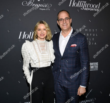 Naomi Watts, David Nevins. Actress Naomi Watts, left, and chairman and CEO of Showtime Networks David Nevins pose together at The Hollywood Reporter's annual Most Powerful People in Media cocktail reception at The Pool, in New York