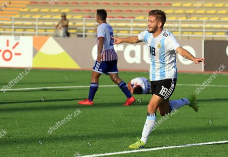 Argentina's Juan Pablo Krilanovich (R) celebrates after scoring during the South American U'17 soccer match between Paraguay and Argentina at Universidad Nacional Mayor de San Marcos stadium in Lima, Peru, 11 April 2019.