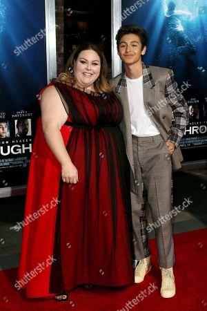 "Chrissy Metz, Marcel Ruiz. Chrissy Metz, left, and Marcel Ruiz arrive at the LA Premiere of ""Breakthrough"" at the Regency Village, in Los Angeles"