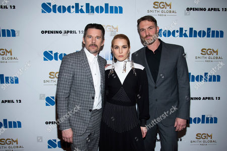 """Ethan Hawke, Noomi Rapace, Robert Budreau. Ethan Hawke, left, Noomi Rapace and Robert Budreau attend the premiere of """"Stockholm"""" at the Museum of Modern Art, in New York"""