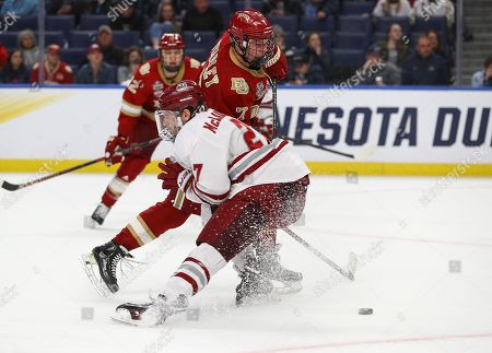 Massachusetts Minutemen defenseman Jake McLaughlin (27) checks Denver Pioneers forward Brett Stapley (7) form the puck during the second period of play in the NCAA Frozen Four Men's Hockey Semi-Final game between the Denver Pioneers and Massachusetts Minutemen at the KeyBank Center in Buffalo , N.Y. (Nicholas T