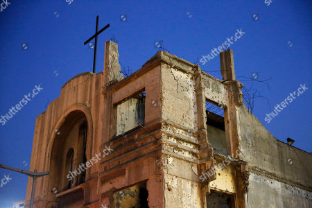 Bullet holes from Lebanon's 1975-1990 civil war are seen on the walls of the St. Vincent de Paul church in downtown Beirut, Lebanon. Nearly 30 years after civil war guns fell silent, dozens of bullet-scarred, shell-pocked buildings are still standing _ testimony to a brutal conflict that raged for 15 years and took the lives of 150,000 people