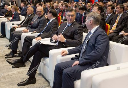 Croatia's Prime Minister Andrej Plenkovic, center, talks with his Bosnian counterpart Denis Zvizdic at the Summit of Central and Eastern Europe and China in Dubrovnik, Croatia, . EU member Croatia is hosting a two-day summit between China and 16 regional countries on expanding business between China and the region, which is dubbed 16+1