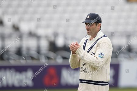 Tim Murtagh of Middlesex CCC blows into his hands on a chill day in the field for the hosts during Middlesex CCC vs Lancashire CCC, Specsavers County Championship Division 2 Cricket at Lord's Cricket Ground on 12th April 2019