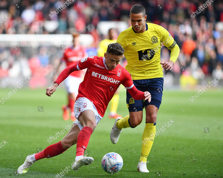 Jack Rodwell (5) of Blackburn closes to tackle Matthew Cash (14) of Nottingham Forest