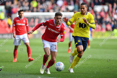 Matthew Cash (14) of Nottingham Forest makes a run with Jack Rodwell (5) of Blackburn closing