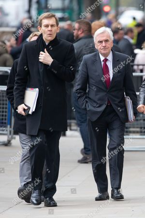Executive Director of Strategy and Communications for the Labour Party Seumas Milne (left) and Shadow Chancellor of the Exchequer John McDonnell (right) arriving at the Cabinet Office