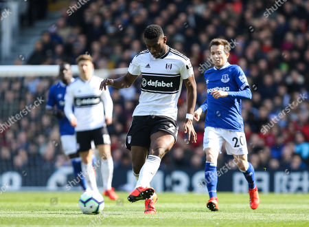 Timothy Fosu-Mensah of Fulham with Bernard of Everton pressuring