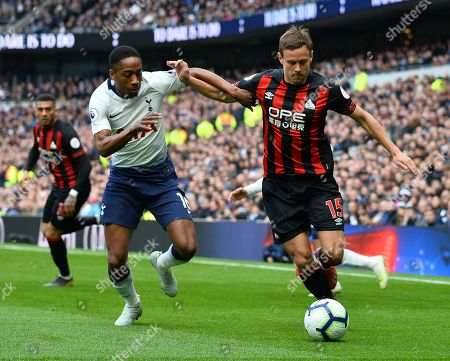 Chris Lowe of Huddersfield Town and Kyle Walker-Peters of Tottenham Hotspur battle for the ball