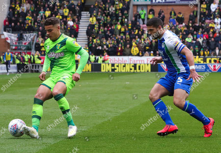 Max Aarons of Norwich City battles with Sam Morsy of Wigan Athletic