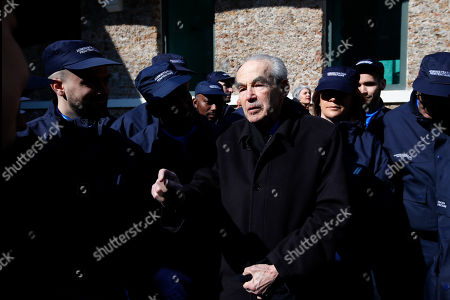 Former Justice minister Robert Badinter shares a moment with security guards at Paris' mythic La Sante prison during a press visit for the official inauguration after a four-year renovation project in Paris, . Opened in 1867, the massive brown edifice in Paris' 14th district has held some of France's most notorious criminals, including international terrorist Carlos The Jackal, Nazi collaborator Maurice Papon, and rogue trader Jerome Kerviel