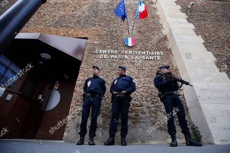 French police officers stand in front of Paris' mythic La Sante prison during a press visit for the official inauguration after a four-year renovation project in Paris, . Opened in 1867, the massive brown edifice in Paris' 14th district has held some of France's most notorious criminals, including international terrorist Carlos The Jackal, Nazi collaborator Maurice Papon, and rogue trader Jerome Kerviel