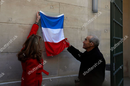 French Justice Minister Nicole Belloubet, left, and former Justice minister Robert Badinter unveil a plaque at Paris' mythic La Sante prison during a press visit for the official inauguration after a four-year renovation project in Paris, . Opened in 1867, the massive brown edifice in Paris' 14th district has held some of France's most notorious criminals, including international terrorist Carlos The Jackal, Nazi collaborator Maurice Papon, and rogue trader Jerome Kerviel