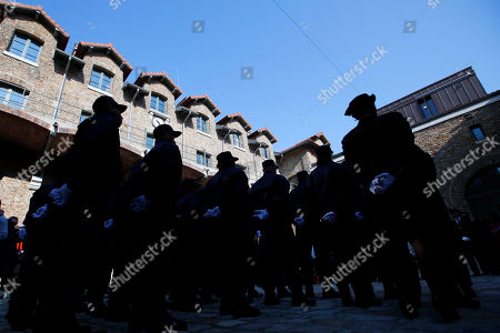 Security guards listen to the speech at Paris' mythic La Sante prison during a press visit for the official inauguration after a four-year renovation project in Paris, . Opened in 1867, the massive brown edifice in Paris' 14th district has held some of France's most notorious criminals, including international terrorist Carlos The Jackal, Nazi collaborator Maurice Papon, and rogue trader Jerome Kerviel