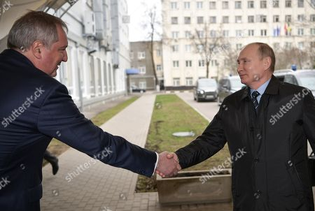 Roscosmos State Space Corporation Director General Dmitry Rogozin (L) shakes hands with Russian President Vladimir Putin (R) while visiting the NPO Energomash enterprise developing and producing liquid rocket engines for space launch vehicles in Khimki, Moscow region, Russia, 12 April 2019, on the Cosmonautics Day dedicated to the first manned space flight. On 12 April 1961 Soviet cosmonaut Yuri Gagarin circled the Earth for 108 minutes aboard the Vostok 1 spacecraft.