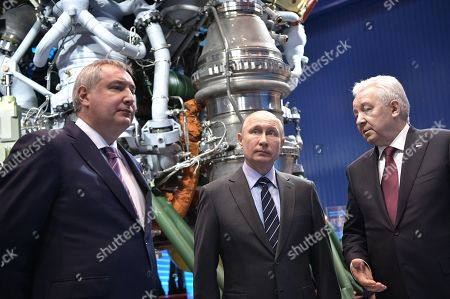 Roscosmos Director Dmitry Rogozin (L), Russian President Vladimir Putin (C) and JSC 'NPO Energomash' Director General Igor Arbuzov (R) visit the NPO Energomash enterprise developing and producing liquid rocket engines for space launch vehicles in Khimki, Moscow region, Russia, 12 April 2019, on the Cosmonautics Day dedicated to the first manned space flight. On 12 April 1961 Soviet cosmonaut Yuri Gagarin circled the Earth for 108 minutes aboard the Vostok 1 spacecraft.