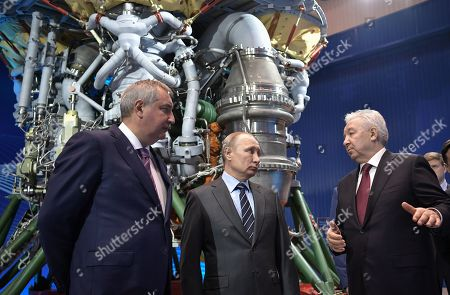 Roscosmos Director Dmitry Rogozin (L), Russian President Vladimir Putin (C) and JSC 'NPO Energomash' Director General Igor Arbuzov (front R) visit the NPO Energomash enterprise developing and producing liquid rocket engines for space launch vehicles in Khimki, Moscow region, Russia, 12 April 2019, on the Cosmonautics Day dedicated to the first manned space flight. On 12 April 1961 Soviet cosmonaut Yuri Gagarin circled the Earth for 108 minutes aboard the Vostok 1 spacecraft.