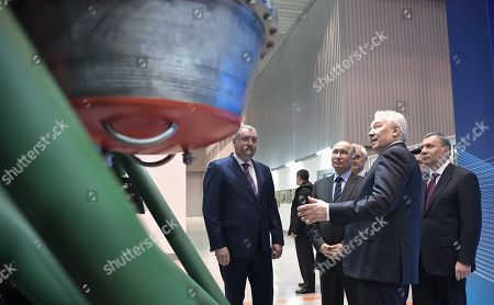 Roscosmos State Space Corporation Director General Dmitry Rogozin (L), Russian President Vladimir Putin (2-L) and Russian Deputy Prime Minister Yuri Borisov (R) listen to JSC 'NPO Energomash' Director General Igor Arbuzov (2-R) while visiting the NPO Energomash enterprise developing and producing liquid rocket engines for space launch vehicles in Khimki, Moscow region, Russia, 12 April 2019, on the Cosmonautics Day dedicated to the first manned space flight. On 12 April 1961 Soviet cosmonaut Yuri Gagarin circled the Earth for 108 minutes aboard the Vostok 1 spacecraft.