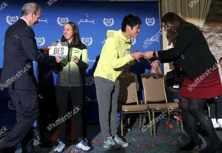 Desiree Linden, Yuki Kawauchi, Tatyana McFadden. Desiree Linden, left, of Washington, Mich., and Yuki Kawauchi, of Japan, receive their assigned bib numbers during a media availability, in Boston in advance of the 123rd Boston Marathon on Monday. Linden won the women's division and Kawauchi won the men's division in the 2018 Boston Marathon