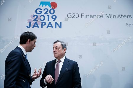 European Central Bank President Mario Draghi (R) speaks with Dutch Finance Minister Wopke Hoekstra (L) following the G-20 meeting at IMF headquarters in Washington, DC, USA, 12  April 2019. International Monetary Fund World Bank Group Spring Meetings run 09-13 April 2019.