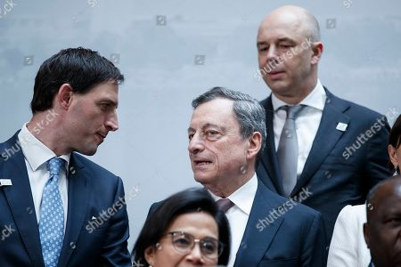European Central Bank President Mario Draghi (C), with Russian Minister of Finance Anton Siluanov (R), speaks with Dutch Finance Minister Wopke Hoekstra (L) following the G-20 meeting at IMF headquarters in Washington, DC, USA, 12 April 2019. International Monetary Fund World Bank Group Spring Meetings run 09-13 April 2019.