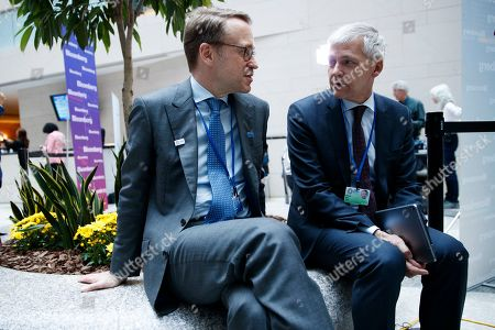President of the Deutsche Bundesbank Jens Weidmann (L) talks with the Director of the Deutsche Bundesbank Mark Best prior to the G-20 meeting at IMF headquarters in Washington, DC, USA, 12  April 2019. International Monetary Fund World Bank Group Spring Meetings run 09-13 April 2019.