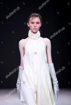 A model presents a creation by Italian fashion designer Alberto Zambelli